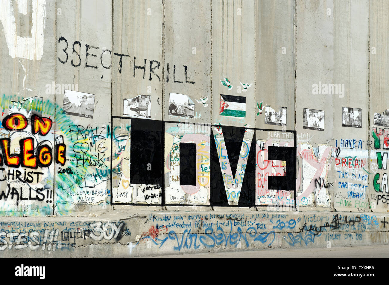 Graffiti on a defensive wall, concrete wall, Israeli separation barrier, border in Bethlehem, Israel, Middle East - Stock Image