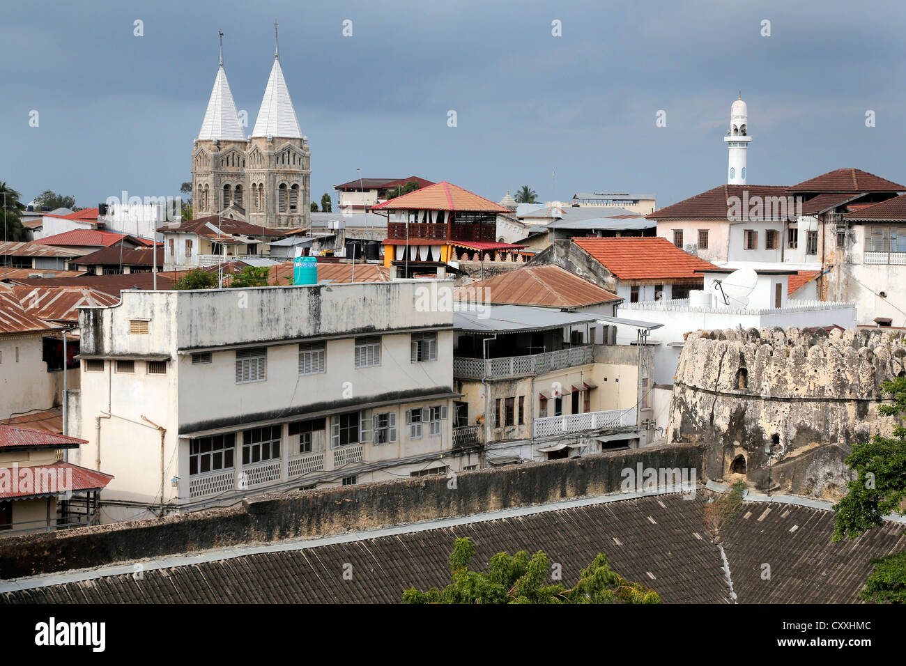 Stonetown of Zanzibar with St Josephs Cathedral and Mosque, Tanzania - Stock Image