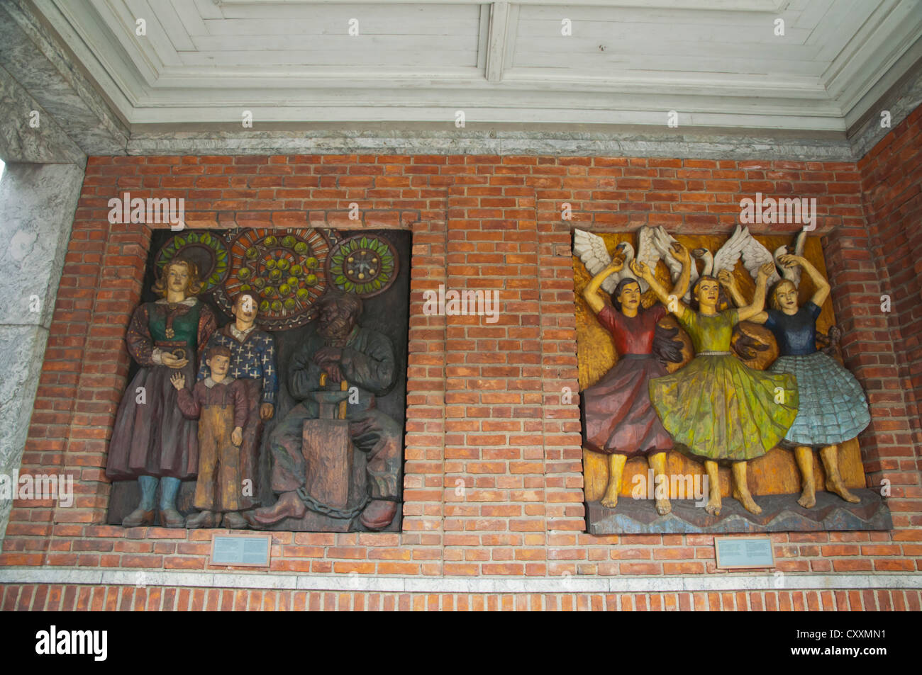 Murals on the wall of Rådhus the Town Hall Sentrum central Oslo Norway Europe - Stock Image