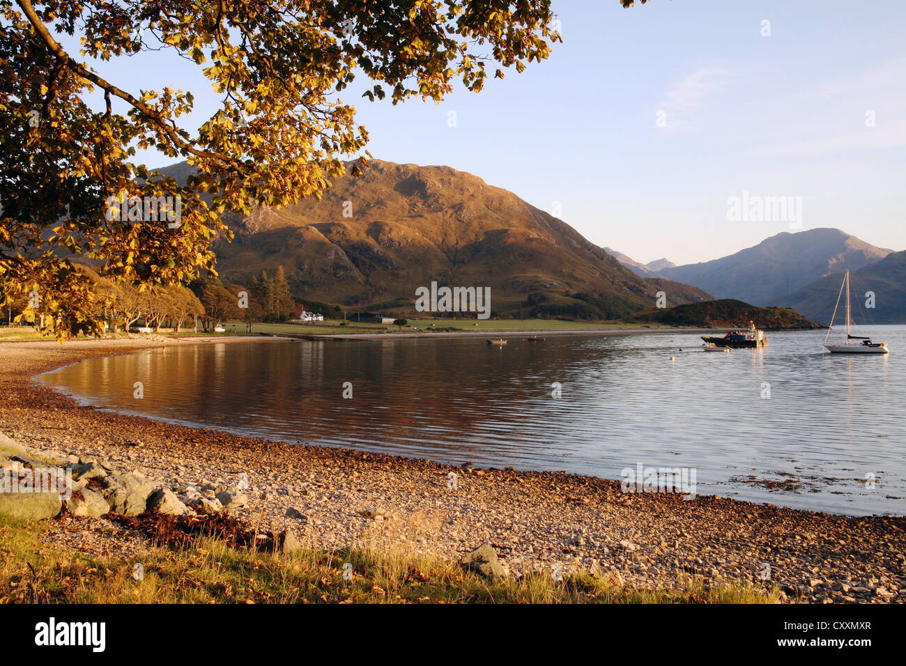 Evening light at Arnisdale on the peaceful shore of Loch Hourn in the Scottish Highlands - Stock Image