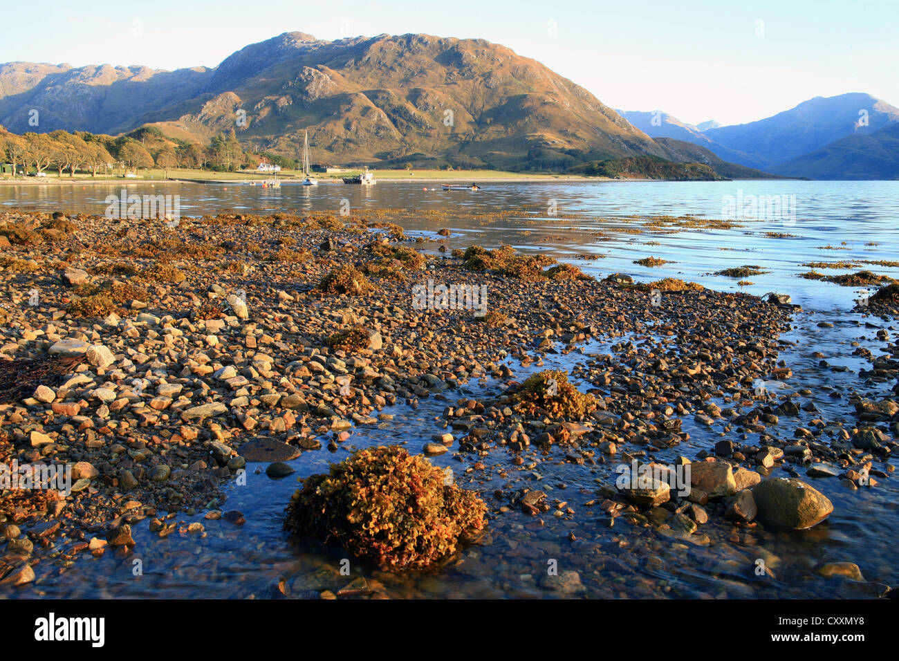 Sunset on the shore of Loch Hourn at Arnisdale in the Scottish Highlands. - Stock Image