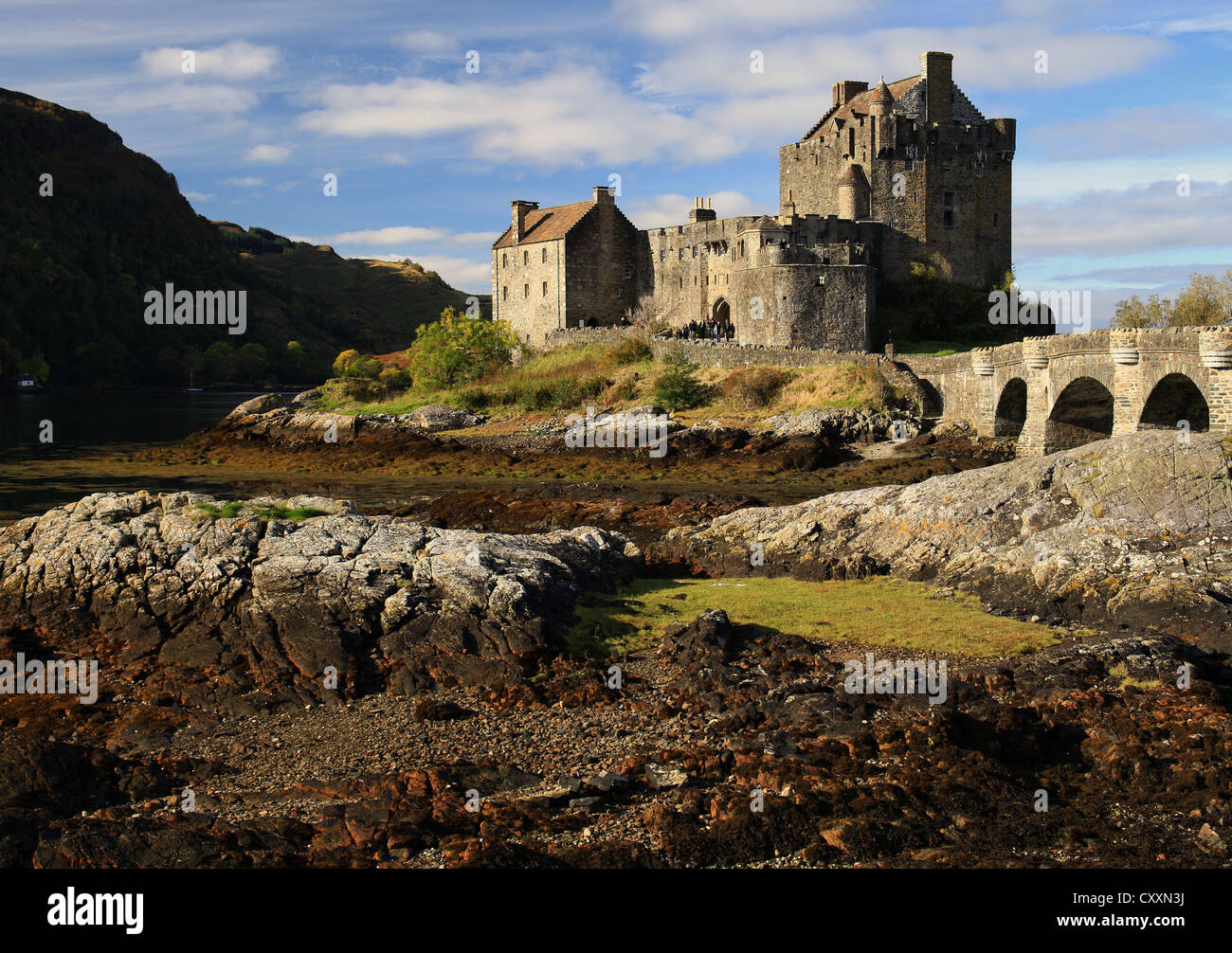 The much visited and picturesque castle of Eilean Donan lies on Loch Duich in the Scottish Highlands - Stock Image