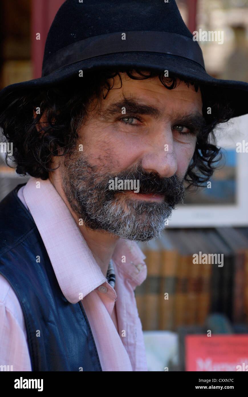 Man moustache, Hat, Librairie Par Chemins, Cours Julien Bookshop, Marseille, Provence Alpes Cote d Azur, France, Stock Photo