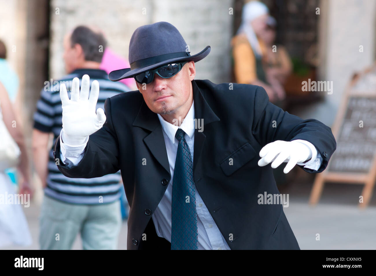 Tallinn, Estonia - July 10, 2010: Street artist with trendy suit performing as a 'Special Agent' living - Stock Image