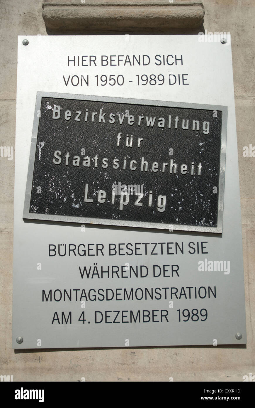 Sign outside the Stasi Museum, Runde Ecke in Leipzig explaining that the headquarters of the Stasi were there from - Stock Image