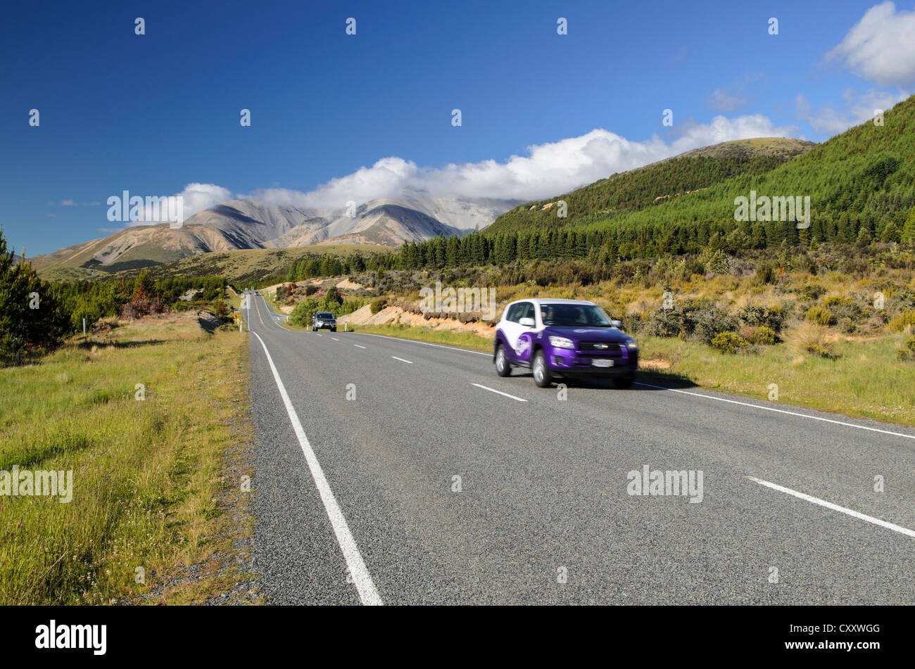 Two cars driving on a country road, driving on the left, Arthur's Pass Road, South Island, New Zealand, Oceania - Stock Image