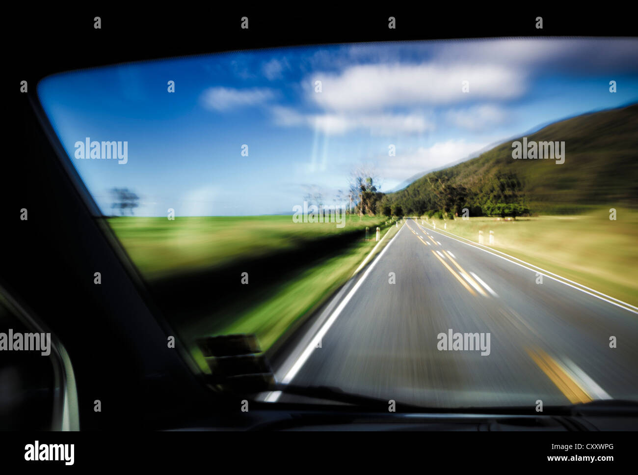 Driving under the influence of alcohol, driving on the left, view from inside a car on the road, driving fast, West - Stock Image