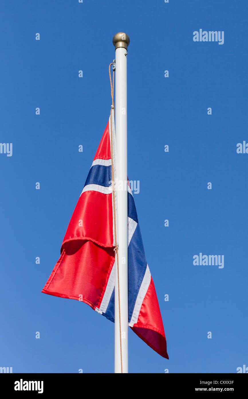 Norwegian flag on a flagpole - Stock Image