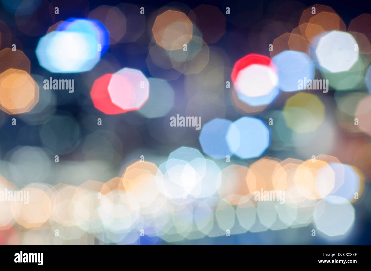 Coloured lights as fuzzy, abstract points of light with coloured lens flare - Stock Image