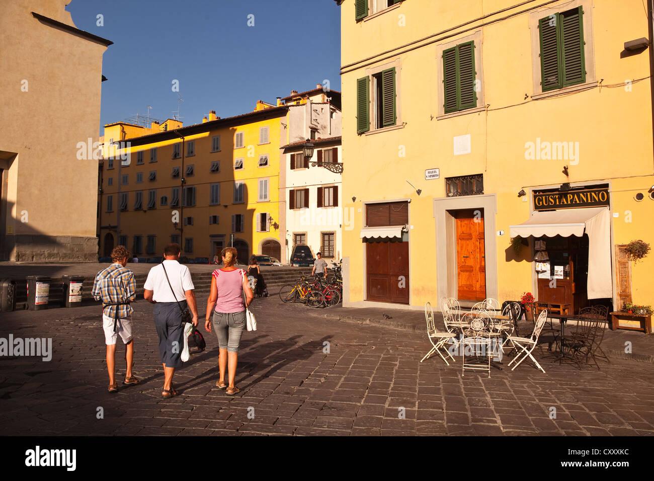 Tourists walking in Piazza Santo Spirito, Florence. Stock Photo