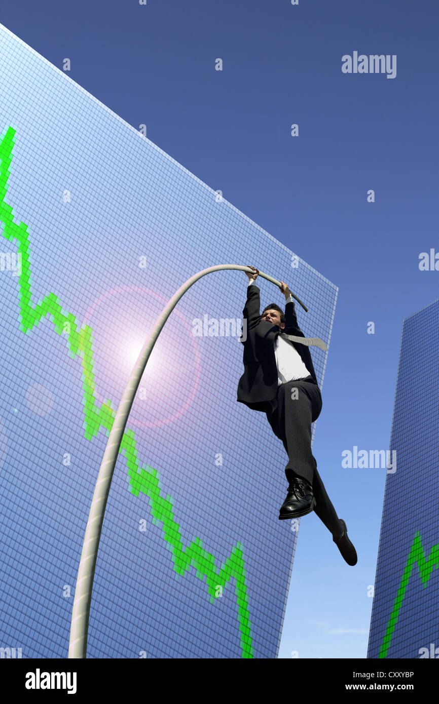 Businessman pole vaulting over a stock course, symbolic image - Stock Image