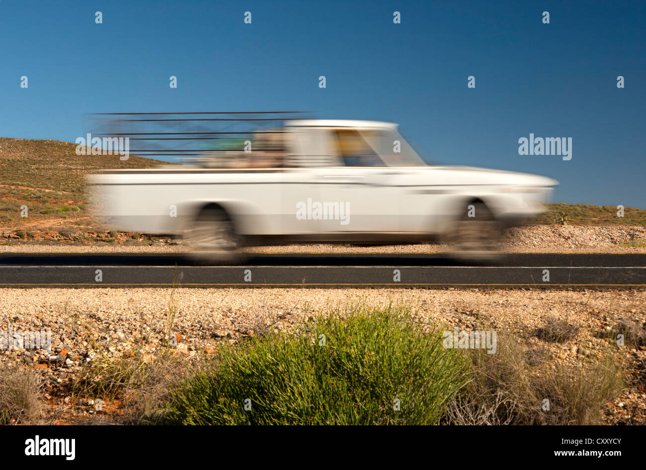 Small van travelling, motion blur, National Road N7, Northern Cape province, South Africa, Africa - Stock Image