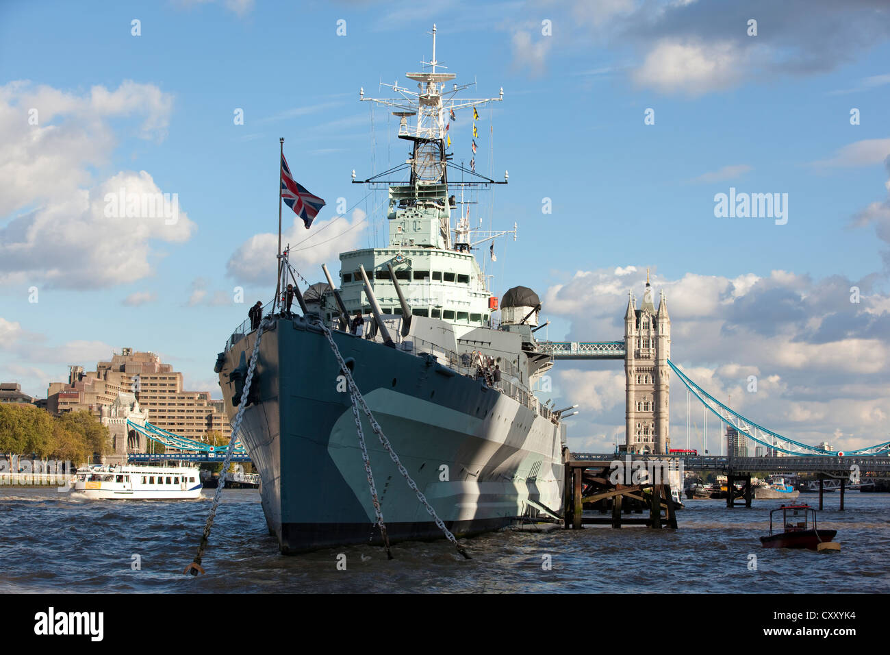 HMS Belfast on the River Thames, in the distance Tower Bridge, London, England, United Kingdom - Stock Image