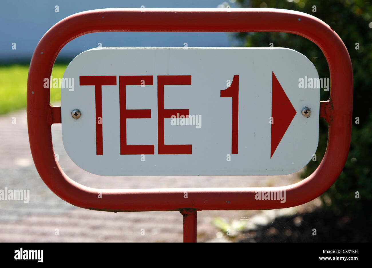 Signpost at a golf course, way to tee 1. - Stock Image