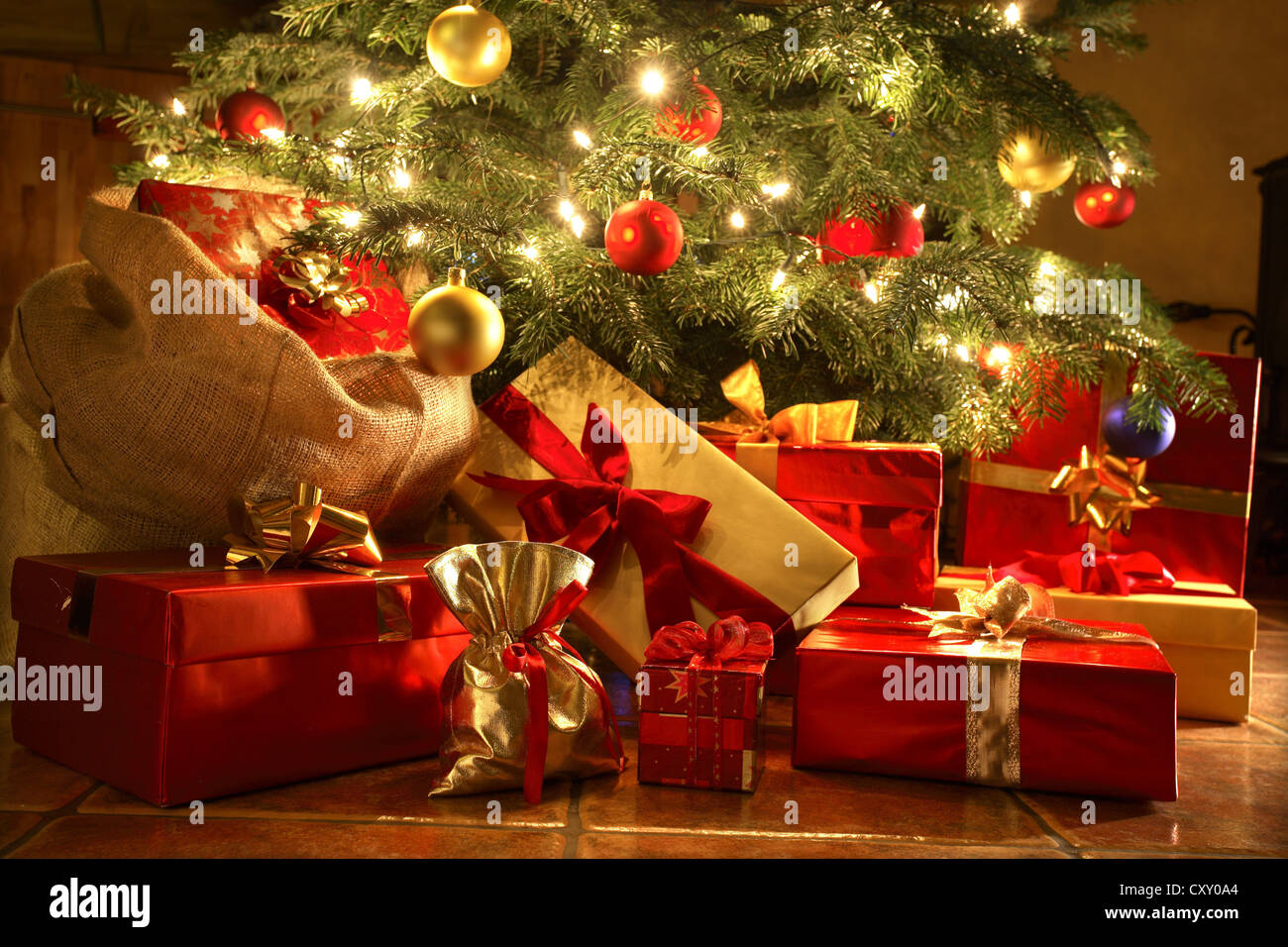 Christmas presents under a Christmas tree - Stock Image