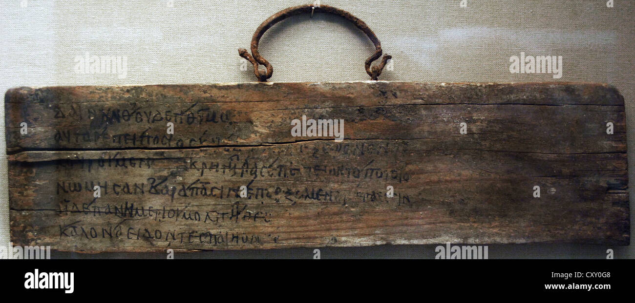 Wooden board with iron handle inscribed in ink with lines 468-473 from Book I of Iliad by Homer. 1st-2nd century - Stock Image