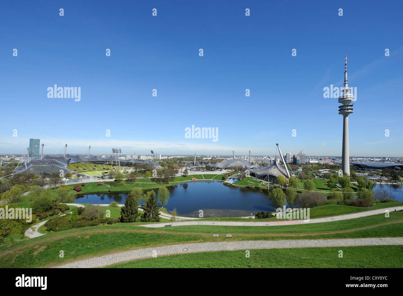 View from Olympiaberg hill to Olympiapark with the Olympic Stadium, swimming pool and TV tower, Munich, Bavaria, Stock Photo