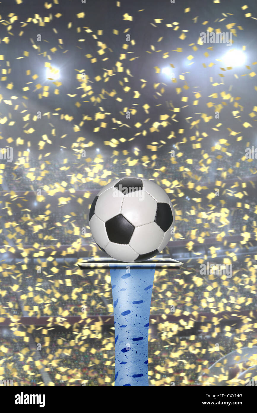 Football on pedestal, confetti, opening game - Stock Image