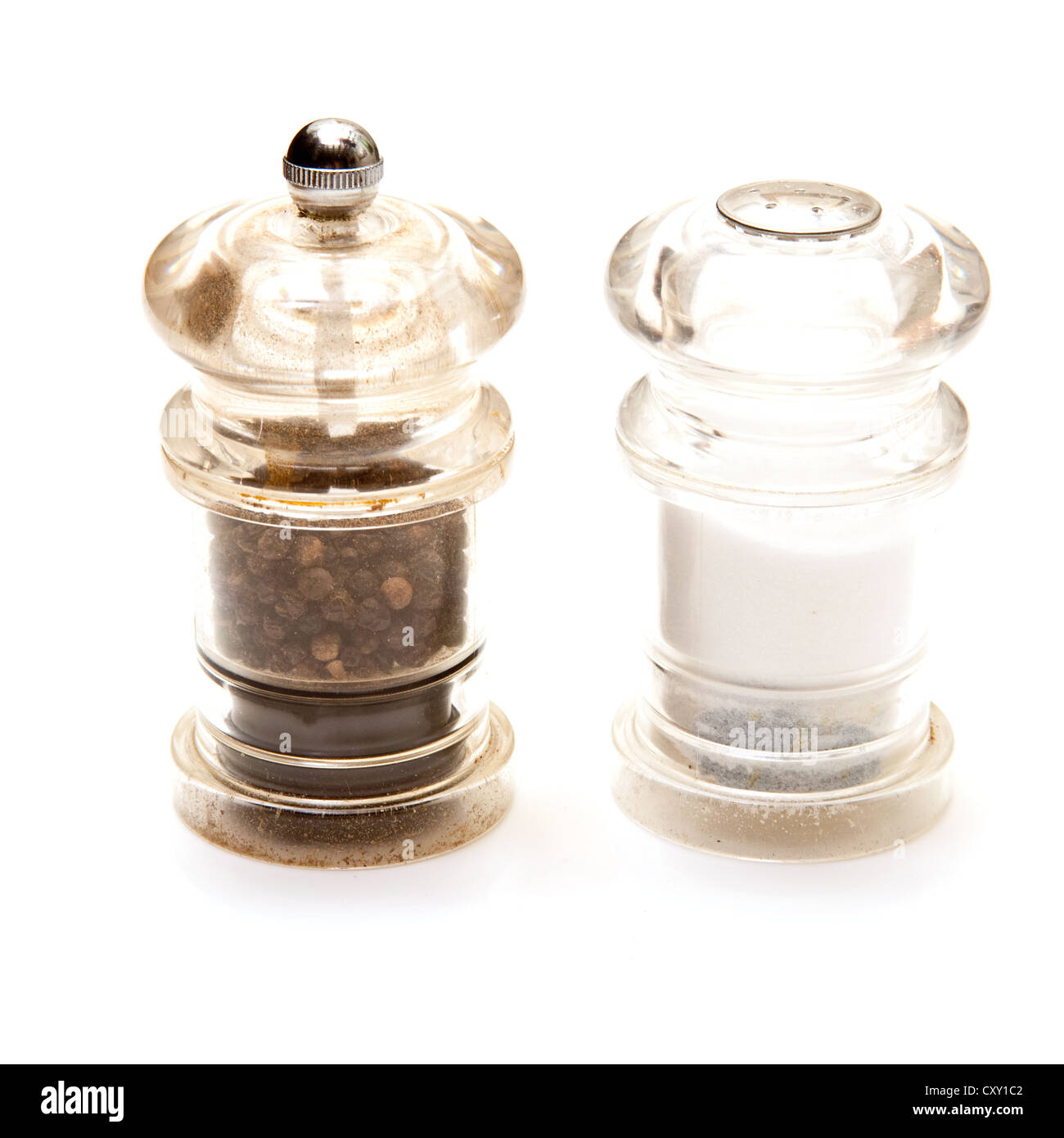 Salt and Pepper grinders isolated on a white studio background. - Stock Image