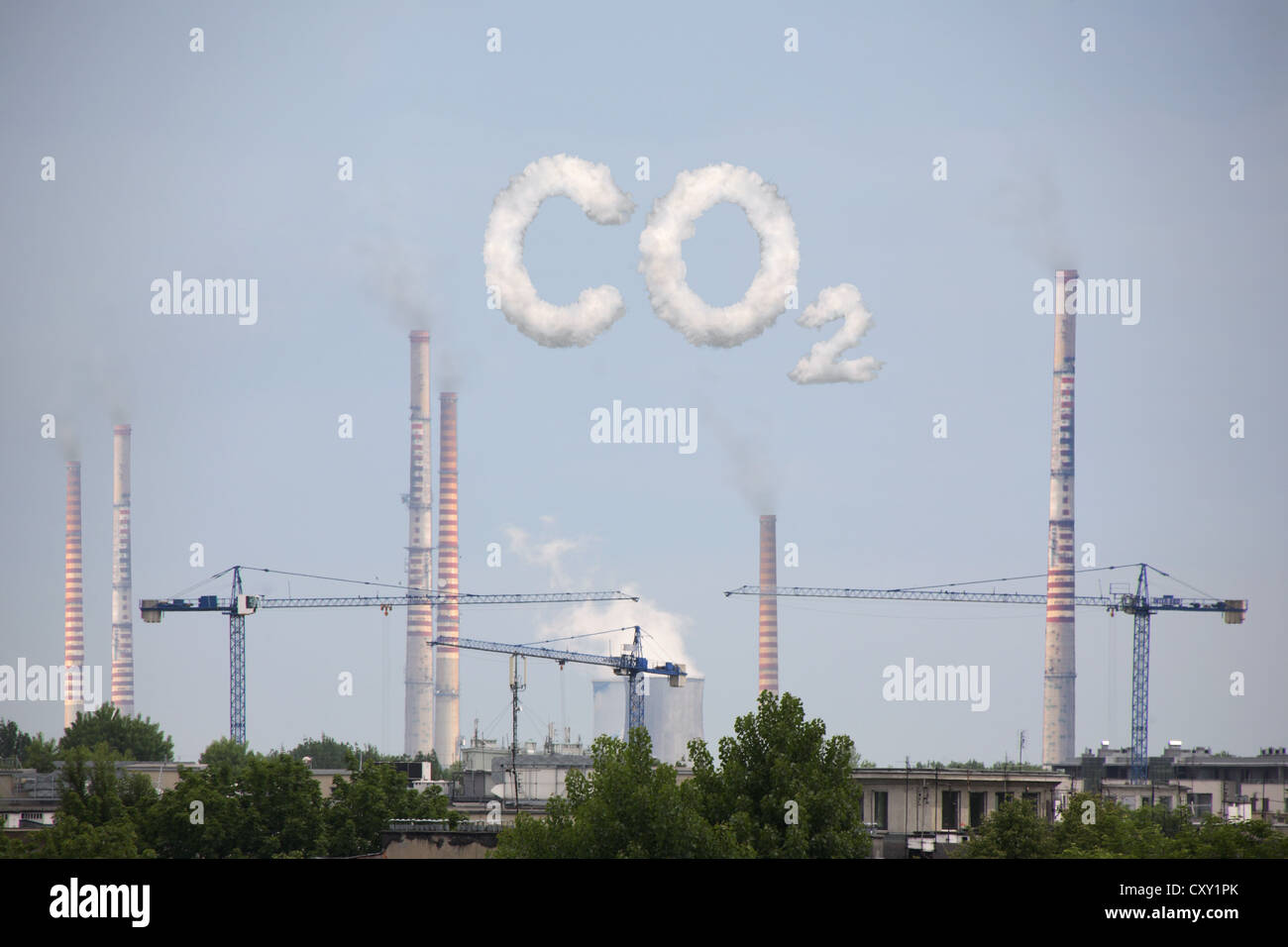 Industrial plant, cloud formation forming the lettering CO2, symbolic image for carbon dioxide emissions, illustration - Stock Image