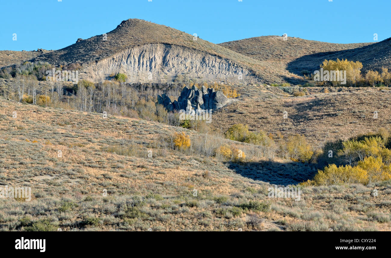 Incision into the landscape, capped hill for a road construction, Highway 20 near Hill City, Idaho, USA - Stock Image