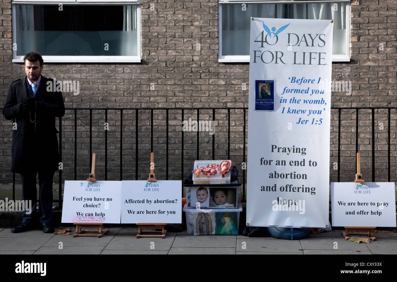 Christian campaign anti-abortion prayer vigil outside birth control clinic in London - Stock Image
