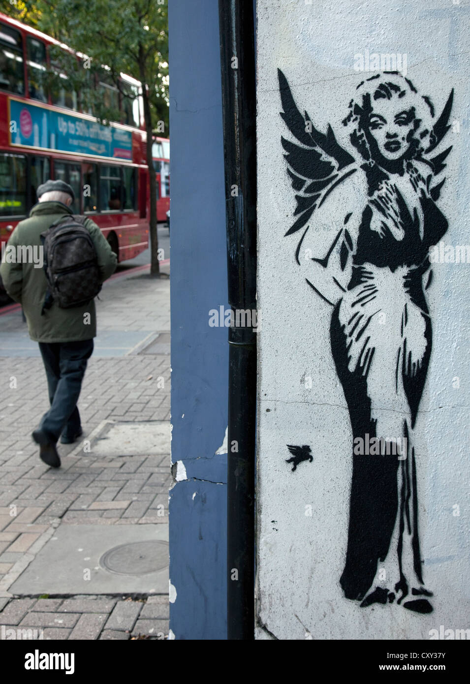 Marilyn Monroe as an angel stencil graffiti in London street - Stock Image