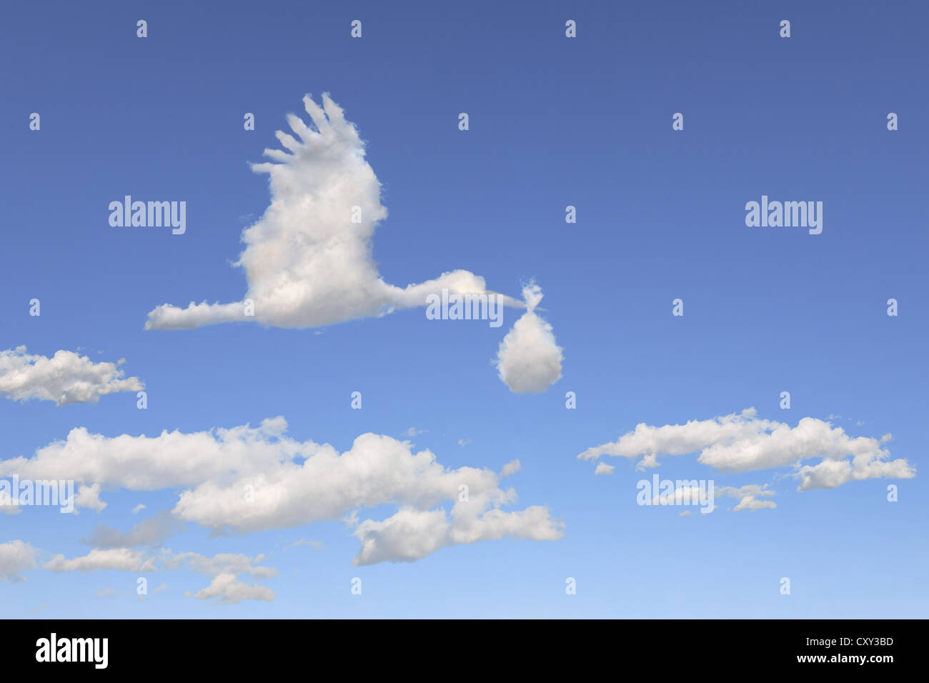 Cloud formations in the shape of a stork holding diapers, illustration - Stock Image