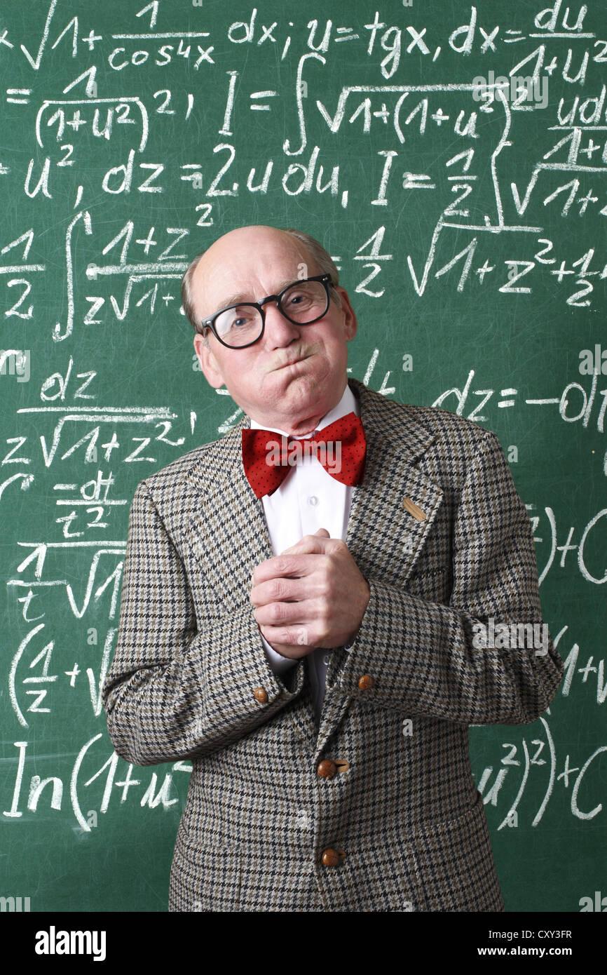 Professor, teacher, blackboard, mathematic formulas, equations, mathematic lessons, maths - Stock Image