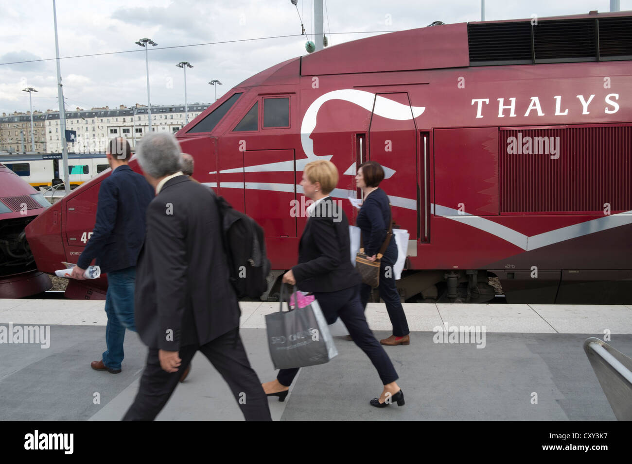 Passengers on platform next to Thalys high speed train at Gare du nord station in Paris France - Stock Image