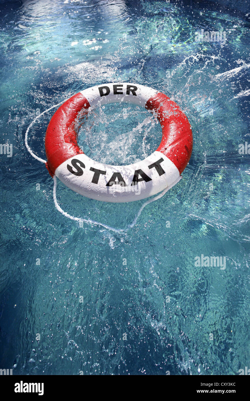 Life ring labelled Der Staat, German for the nation, being thrown into the water, symbolic image - Stock Image