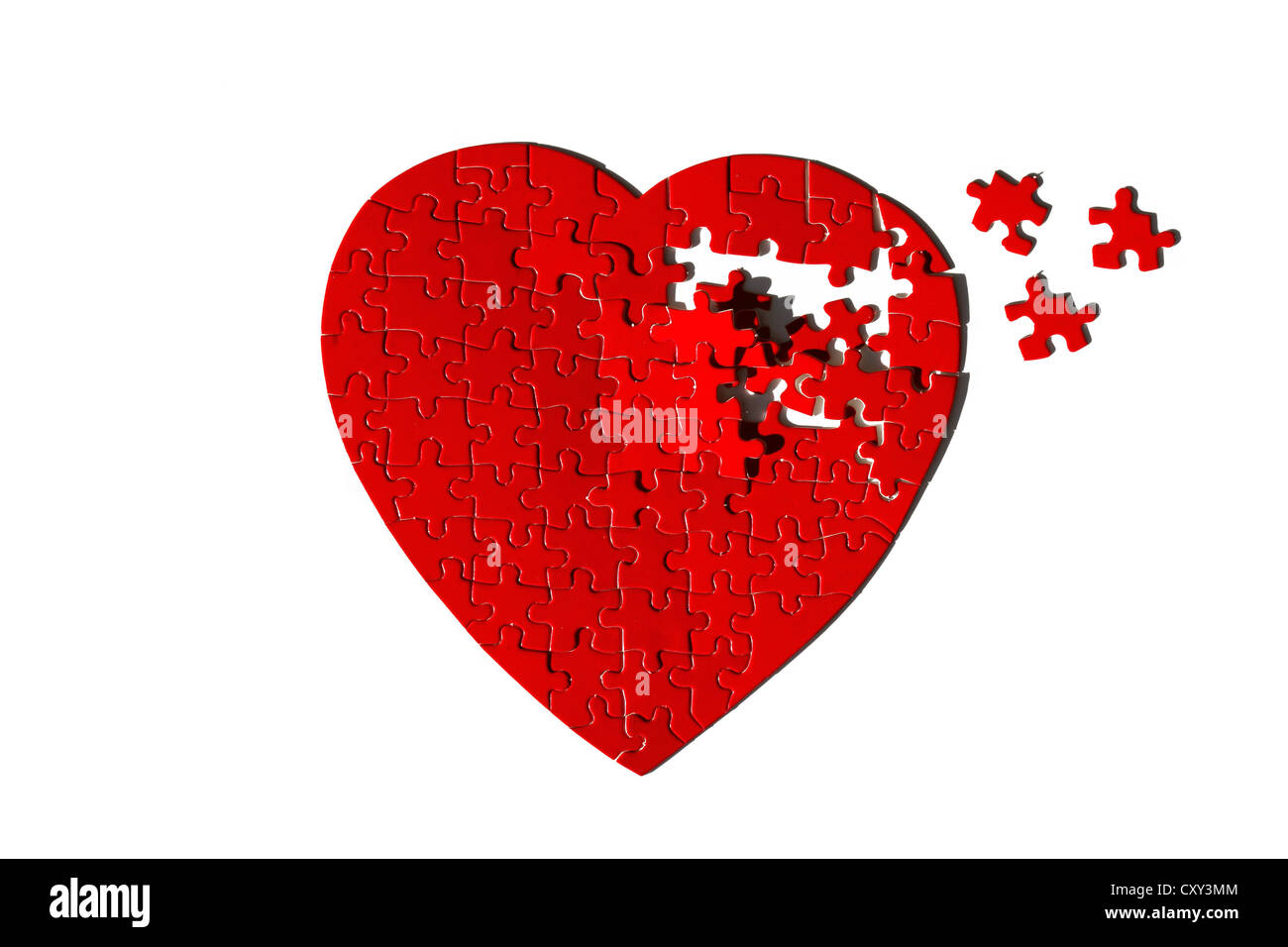 Red heart-shaped jigsaw puzzle, incomplete - Stock Image