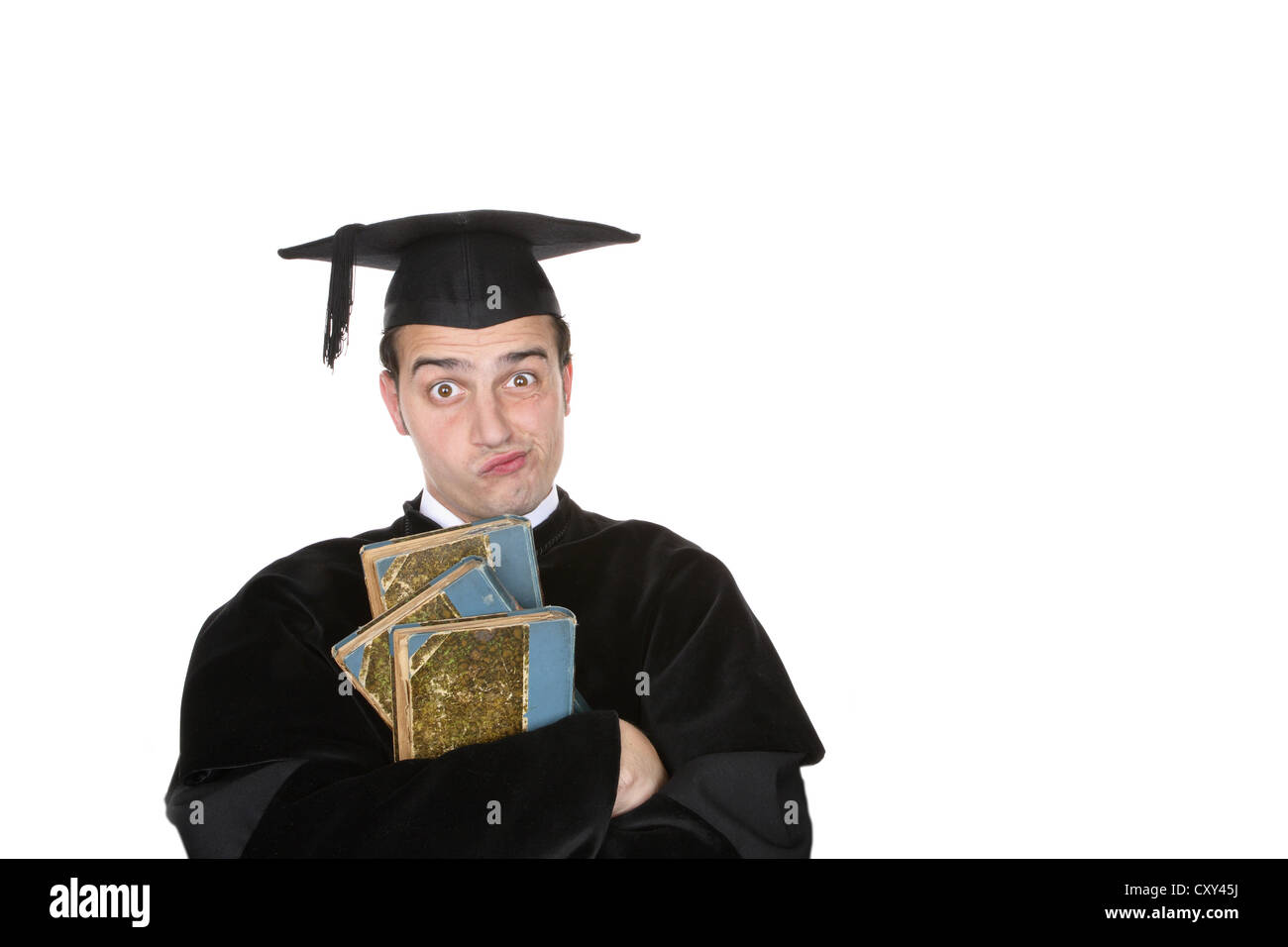 Student wearing a graduation cap and looking skeptical - Stock Image