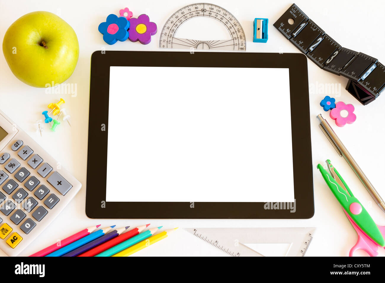 Tablet PC with school accesories on white background - Stock Image