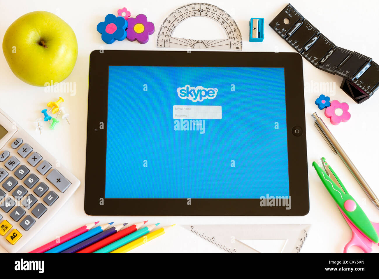 Skype on Ipad 3 with school accesories on white background - Stock Image