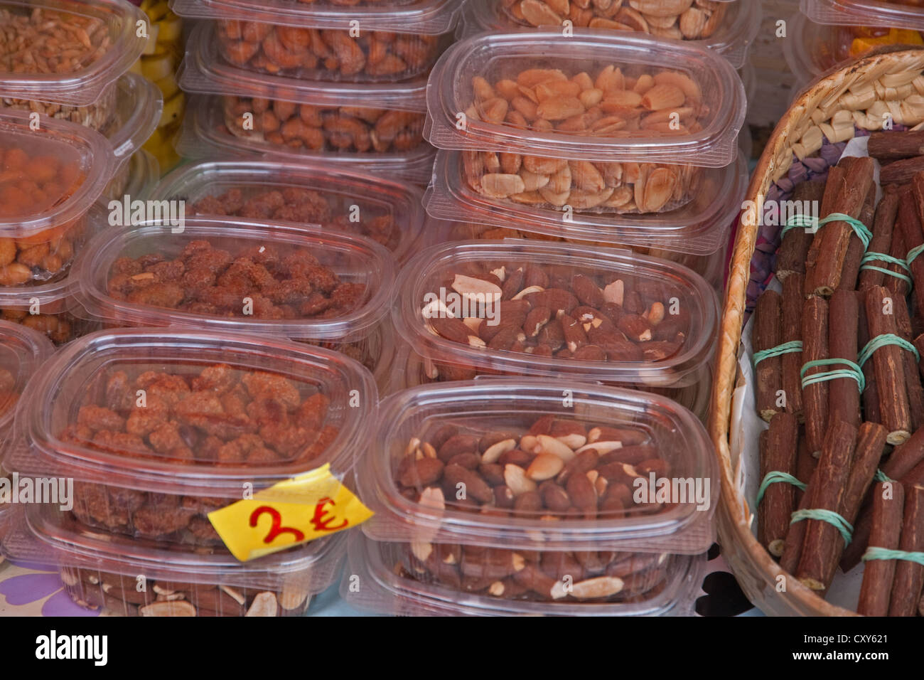 Cartons of nuts and licorice sticks for sale at roadside stall, Spain - Stock Image