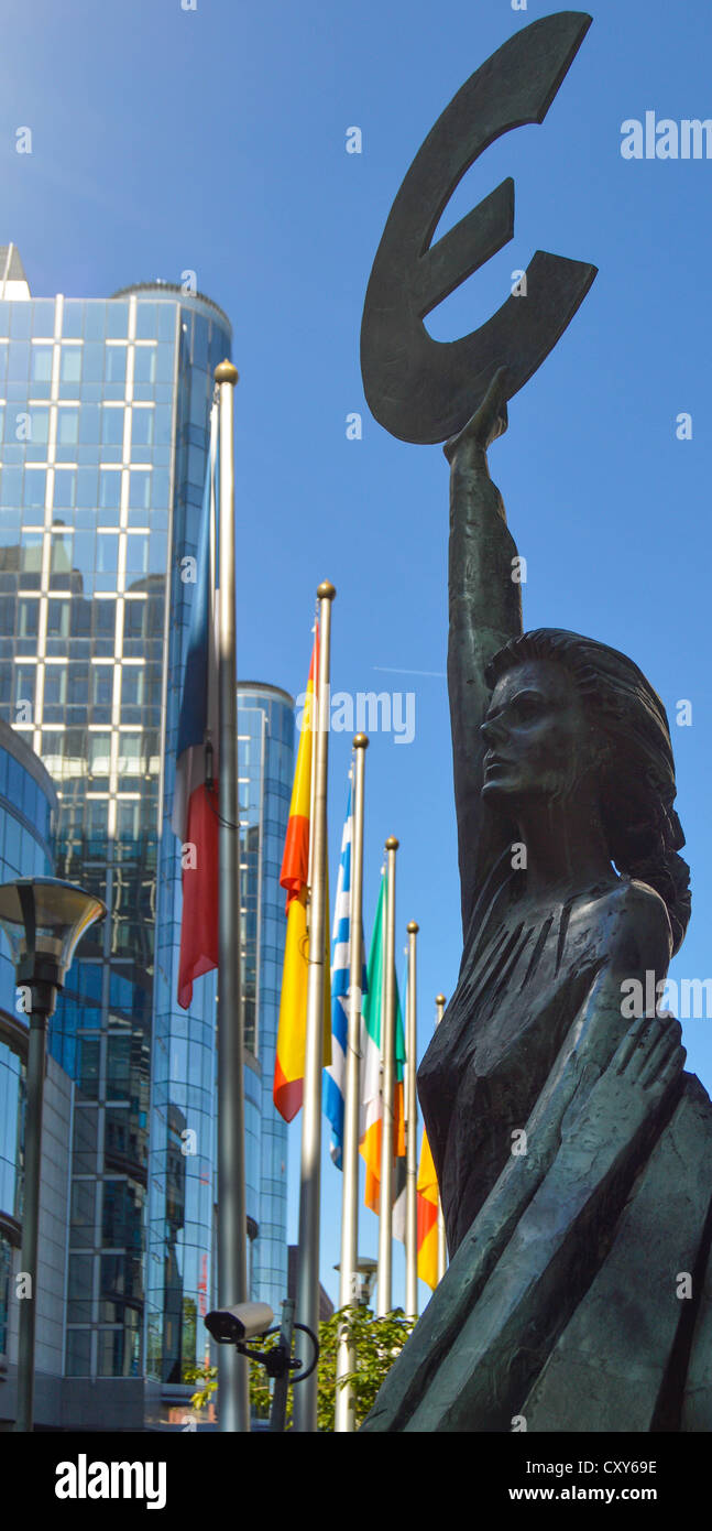 Europa holding a Euro symbol, outside the offices of the European Parliament, Brussels, Belgium (European flags - Stock Image