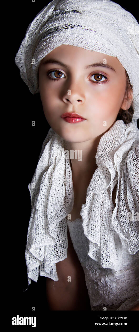 Young girl wearing head scarf. - Stock Image
