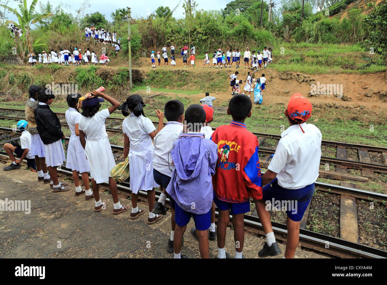 Schoolchildren at Demodara train station near Ella in the Sri Lanka highlands. Stock Photo