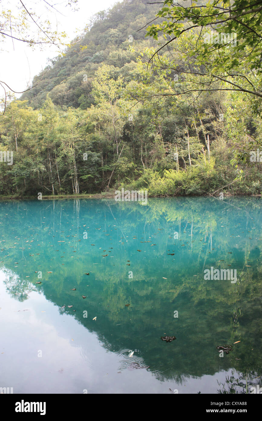 xiaoqikong, Libo, Guizhou, china. The calcium carbonate naturally makes the water this color of blue. Stock Photo