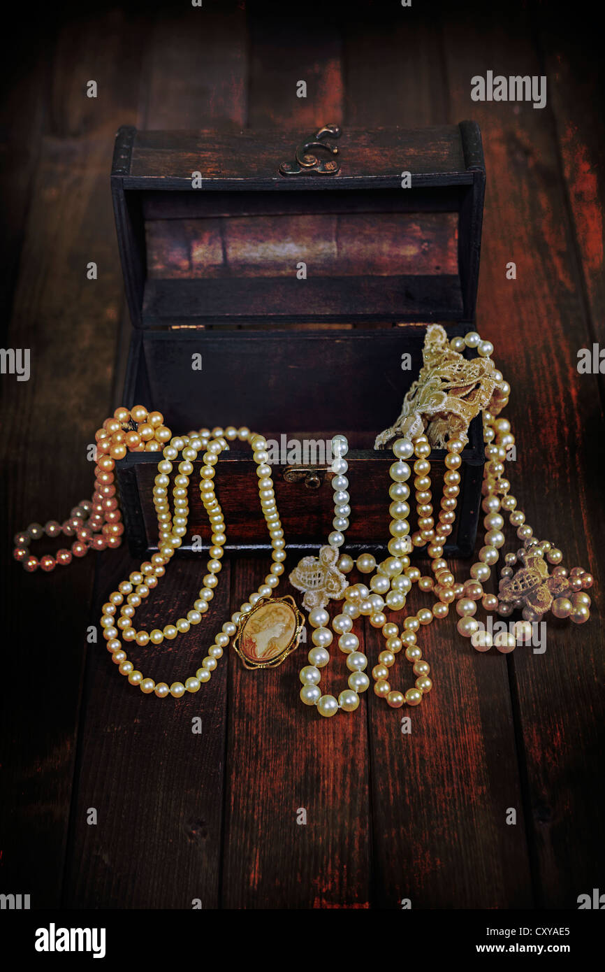 a treasure chest full of jewelry - Stock Image