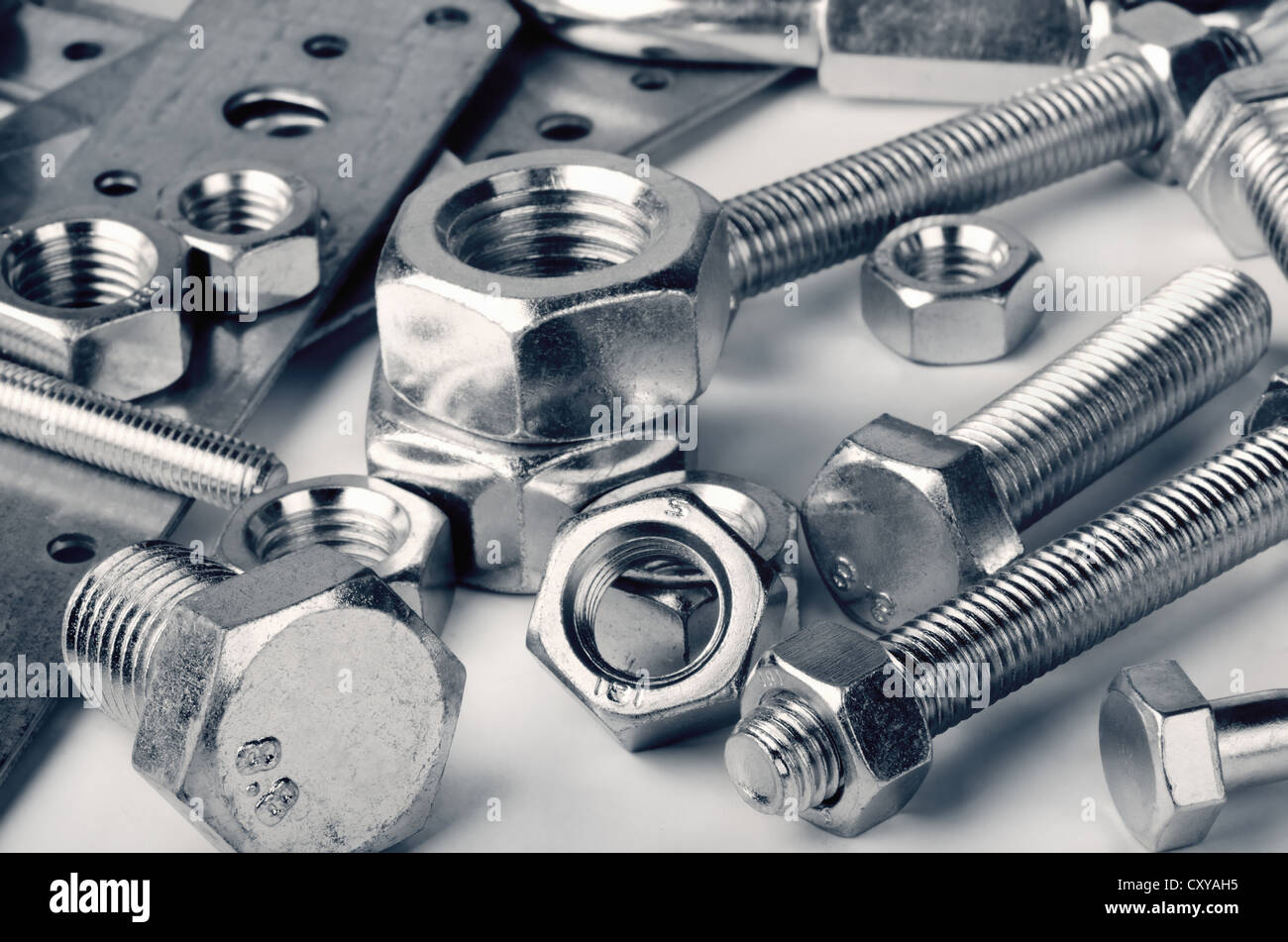 Close-up of various steel nuts and bolts - Stock Image