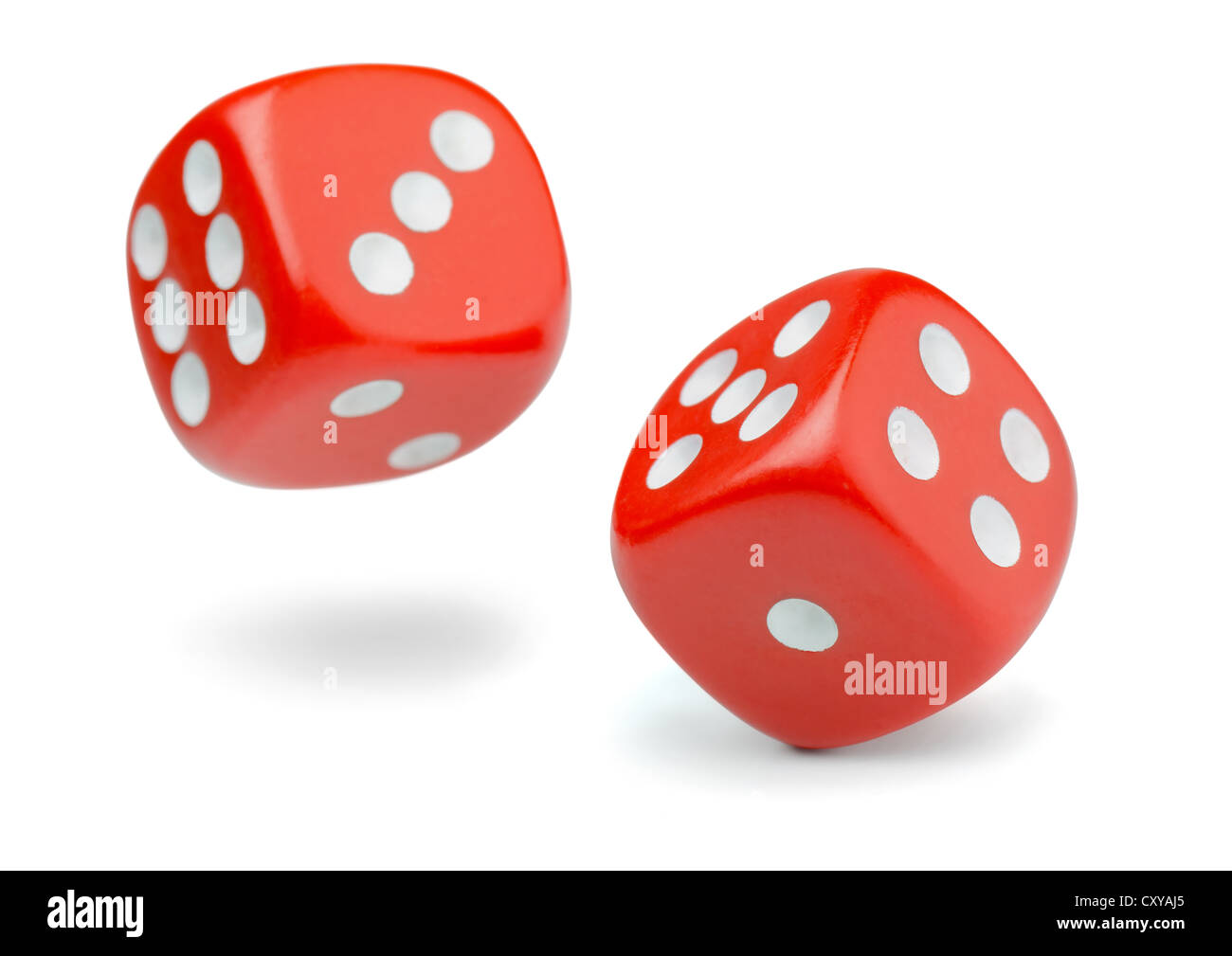 Two rolling red dice isolated on white - Stock Image