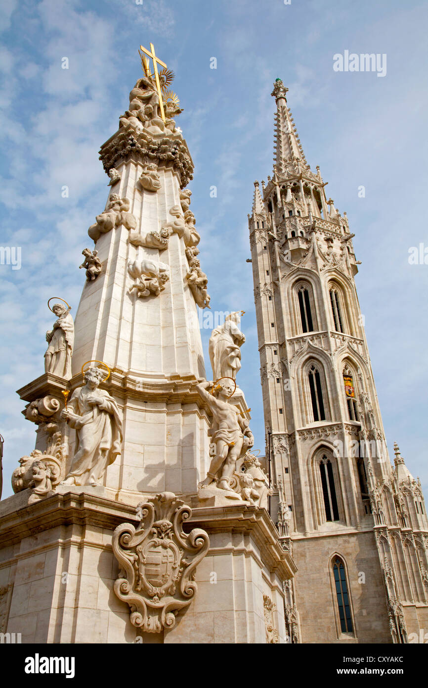 Budapest - St. Matthew's gothic Cathedral and baroque Trinity column - Stock Image
