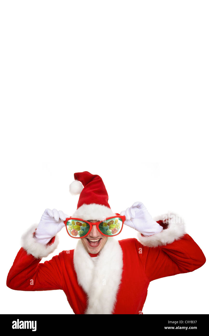 5fc60c034470a Smiling man dressed as Santa Claus wearing oversized novelty glasses ...