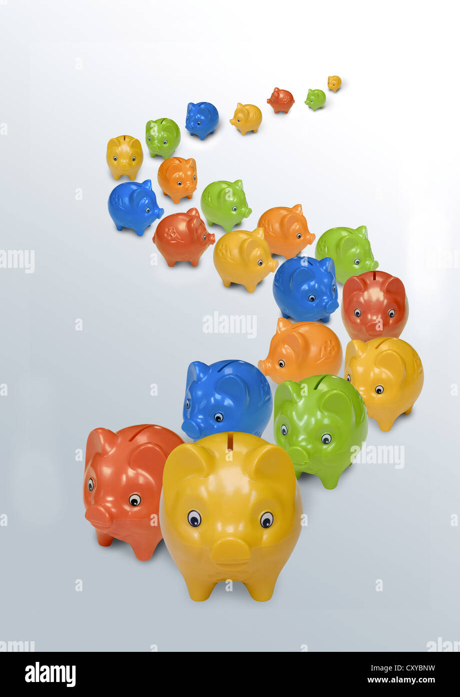 Many colourful piggy banks in a row - Stock Image
