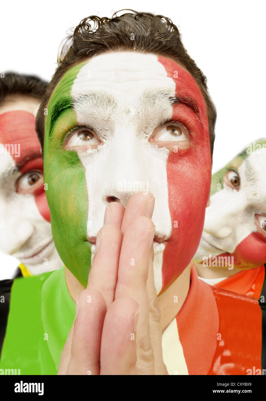 Football fan with his face painted in the national colours of Italy - Stock Image