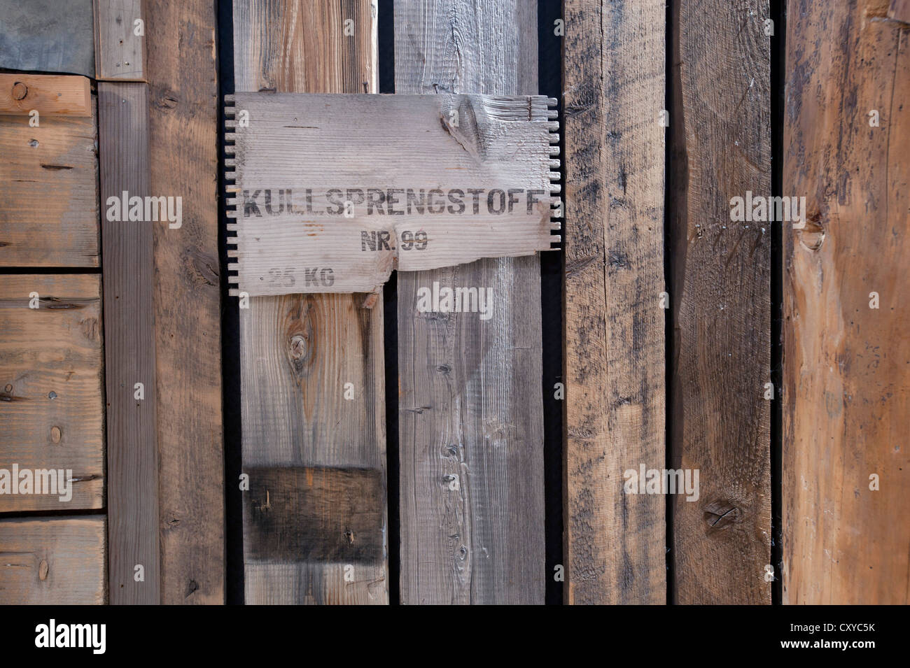 Old wooden planks, part of an explosives' crate, wall decorations, Basecamp Trapper's Hotel, Longyearbyen, - Stock Image
