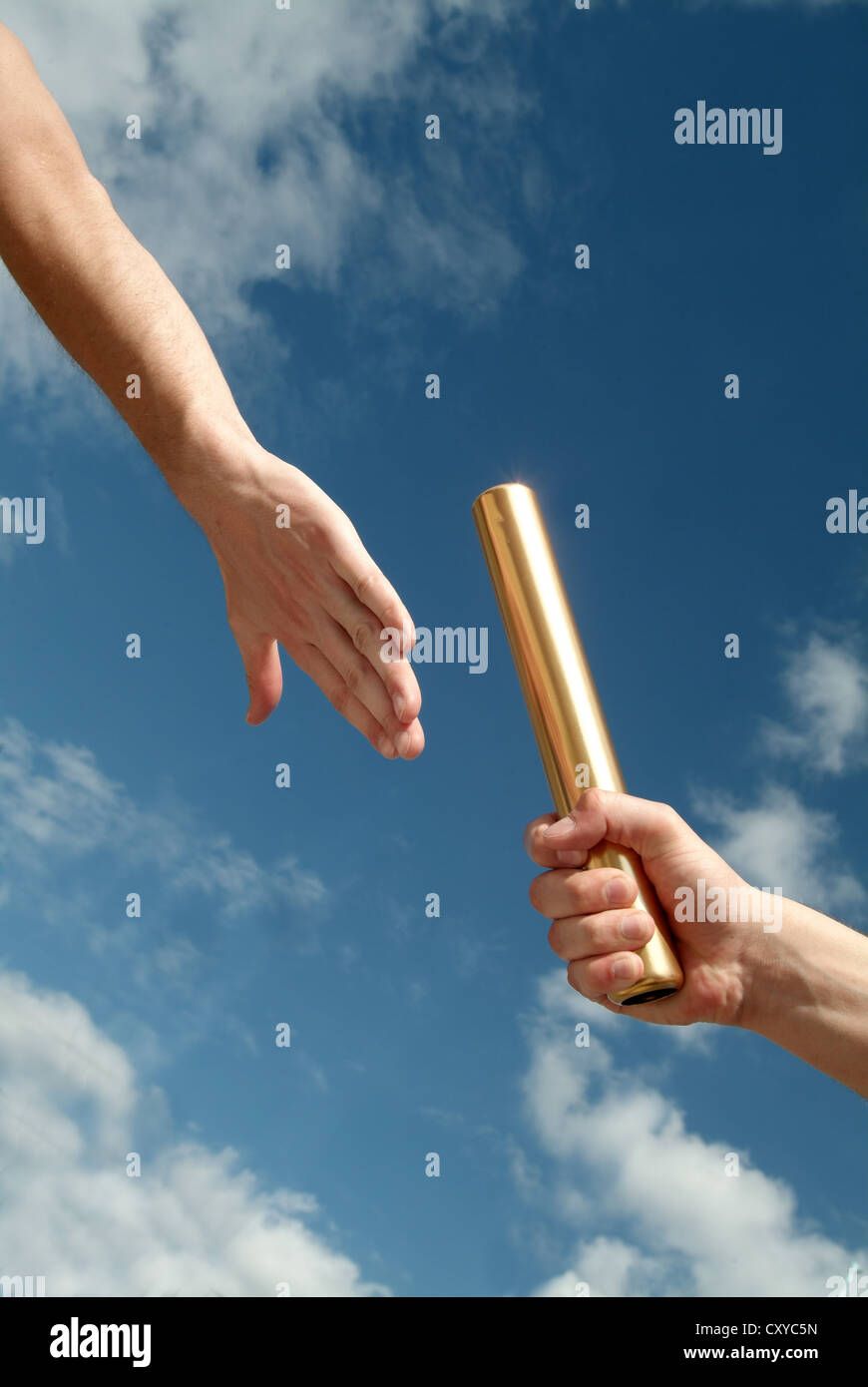 Relay race, detail of athletes hands during the handover of the baton - Stock Image