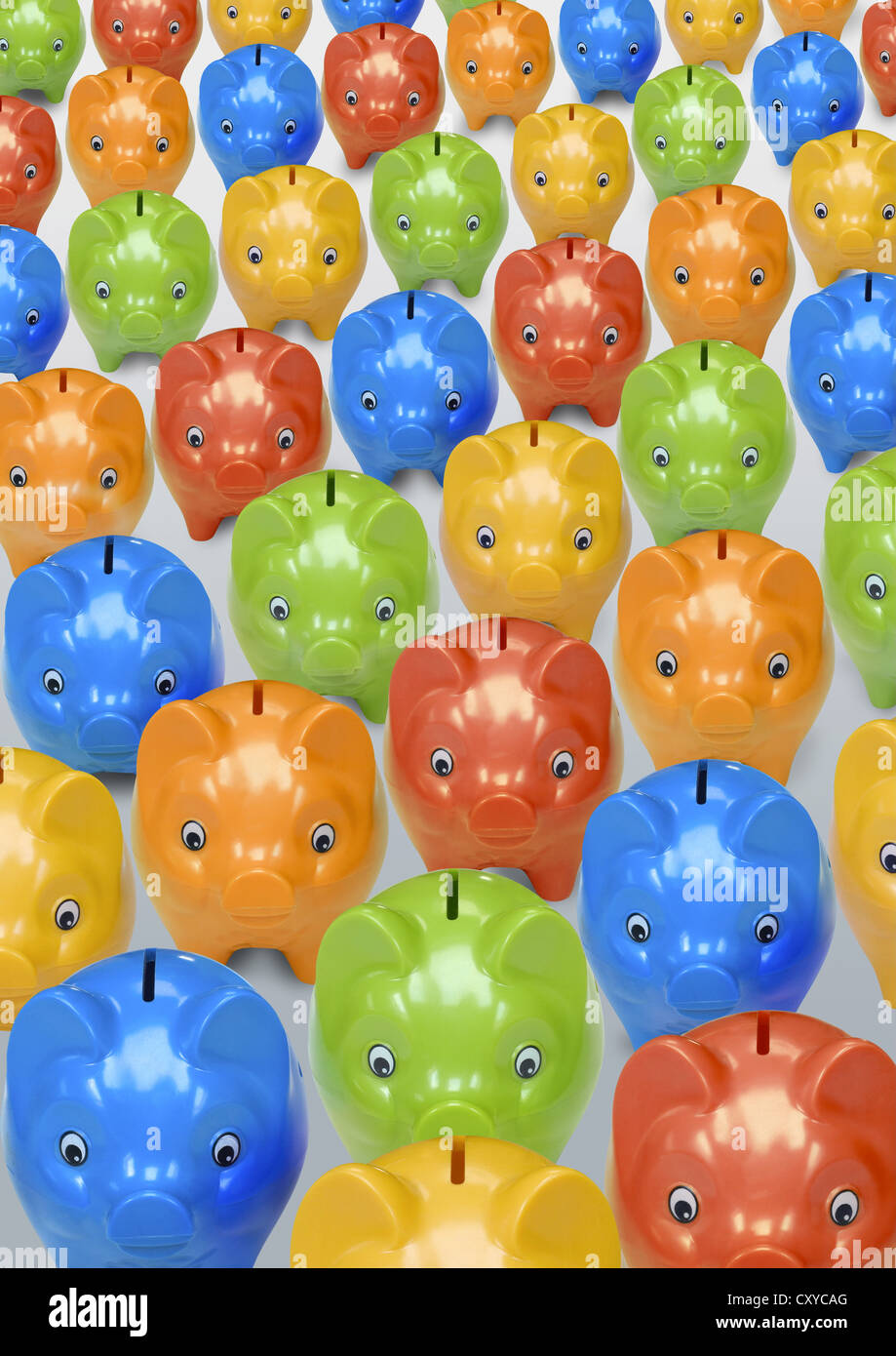 Many colourful piggy banks - Stock Image